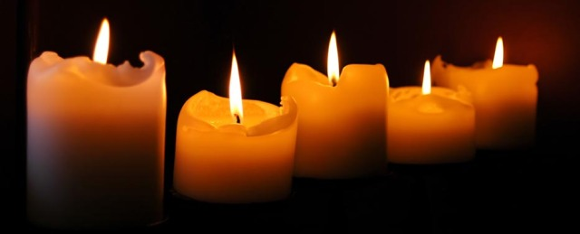 Votive Candles in the Dark